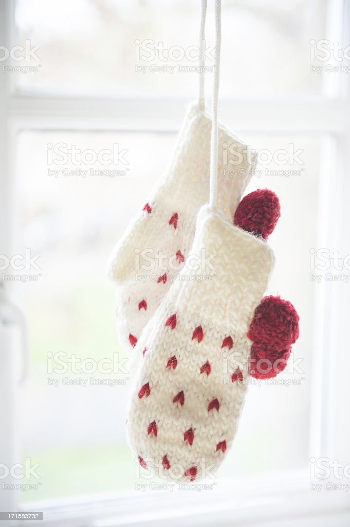 Love mittens hanging by the window royalty-free stock photo