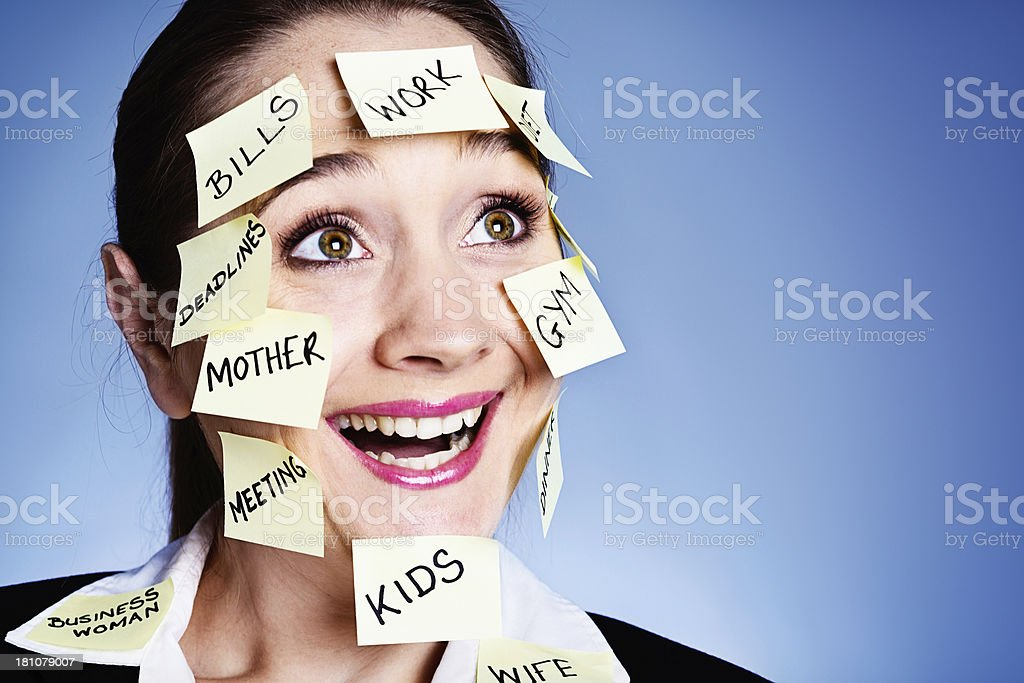 I love multitasking! Smiling woman covered in  task reminders royalty-free stock photo