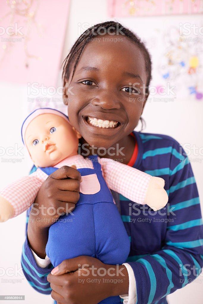 I love my doll! stock photo
