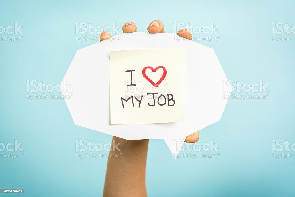 I love (heart) my job. Hand showing message, speech bubble. stock photo