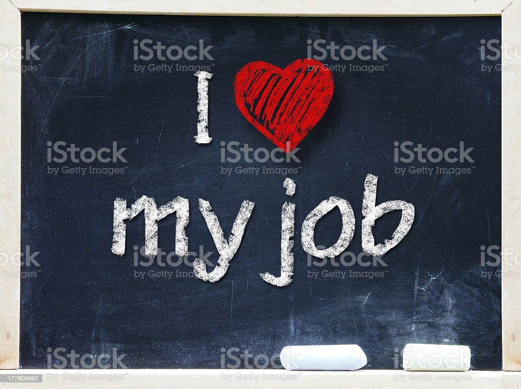 I love my job handwritten  on a blackboard. royalty-free stock photo