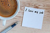 I love my job motivation inscription on peace of paper