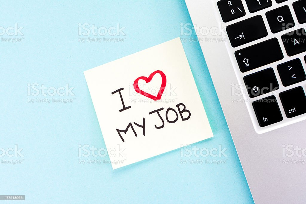 'I love my job' note/message and keyboard notebook. stock photo