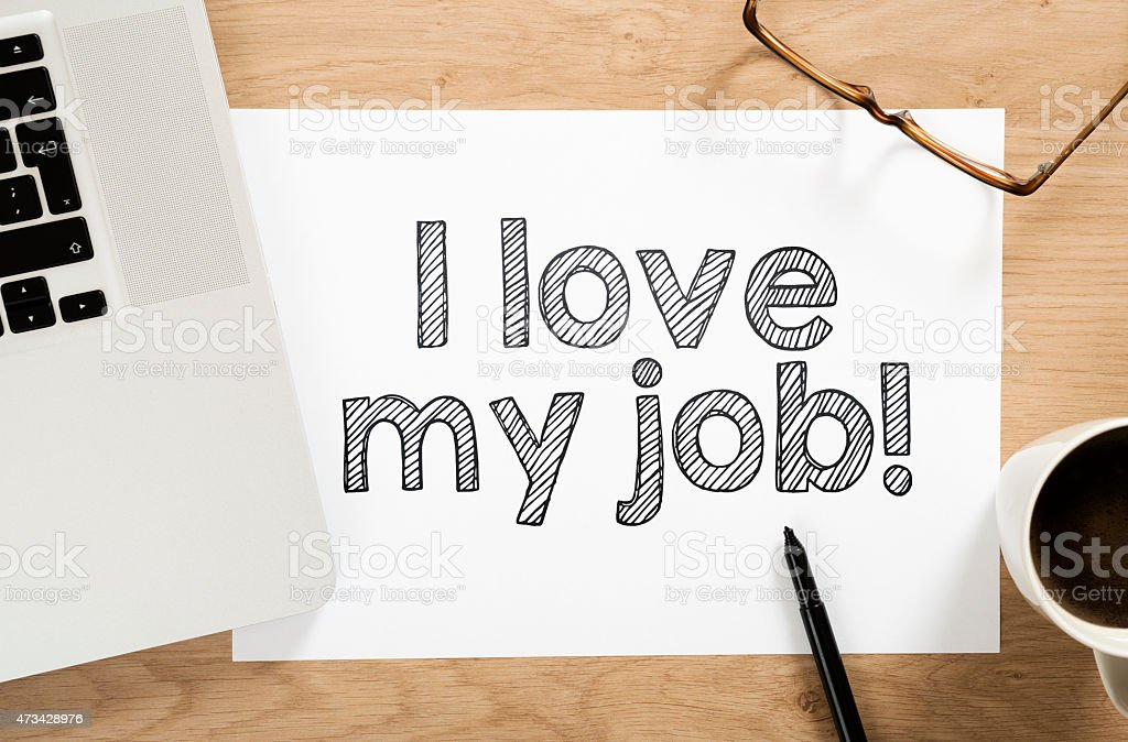 'I love my job' written paper on the office desk stock photo