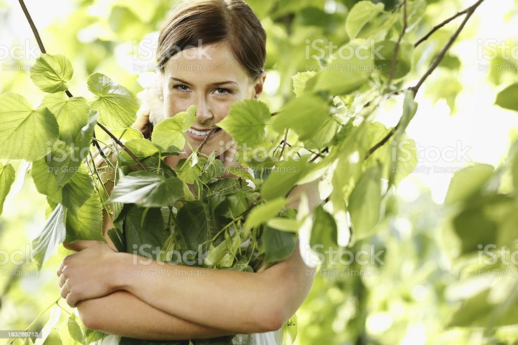 I love nature - Happy woman hugging fresh leaves royalty-free stock photo