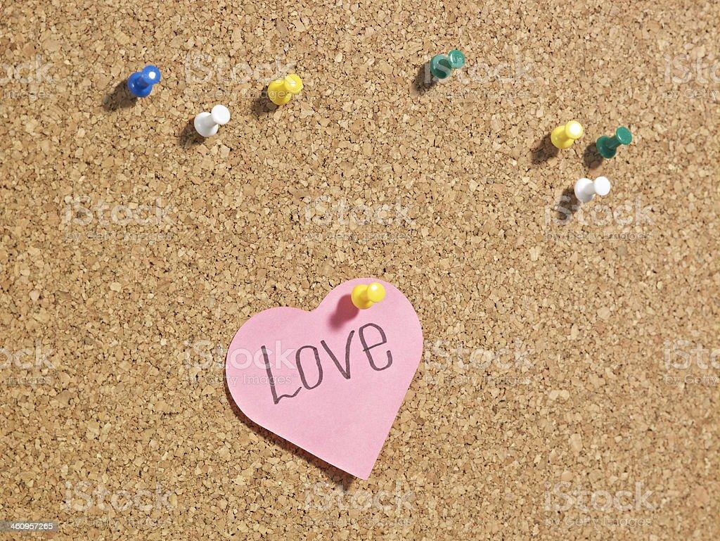 Love note thumb tacked on bulletin board royalty-free stock photo