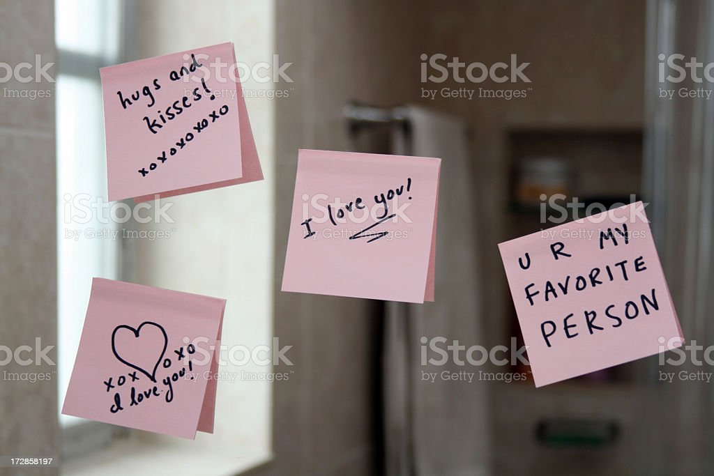 Love notes on sticky paper stuck up on a mirror stock photo