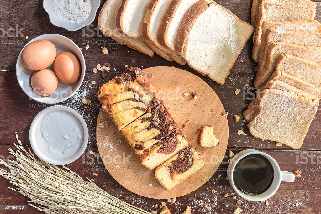 Love  of Coffee cup and chocolate marble cake with bread stock photo