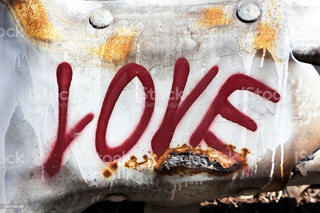 Love on a Battered Guardrail stock photo
