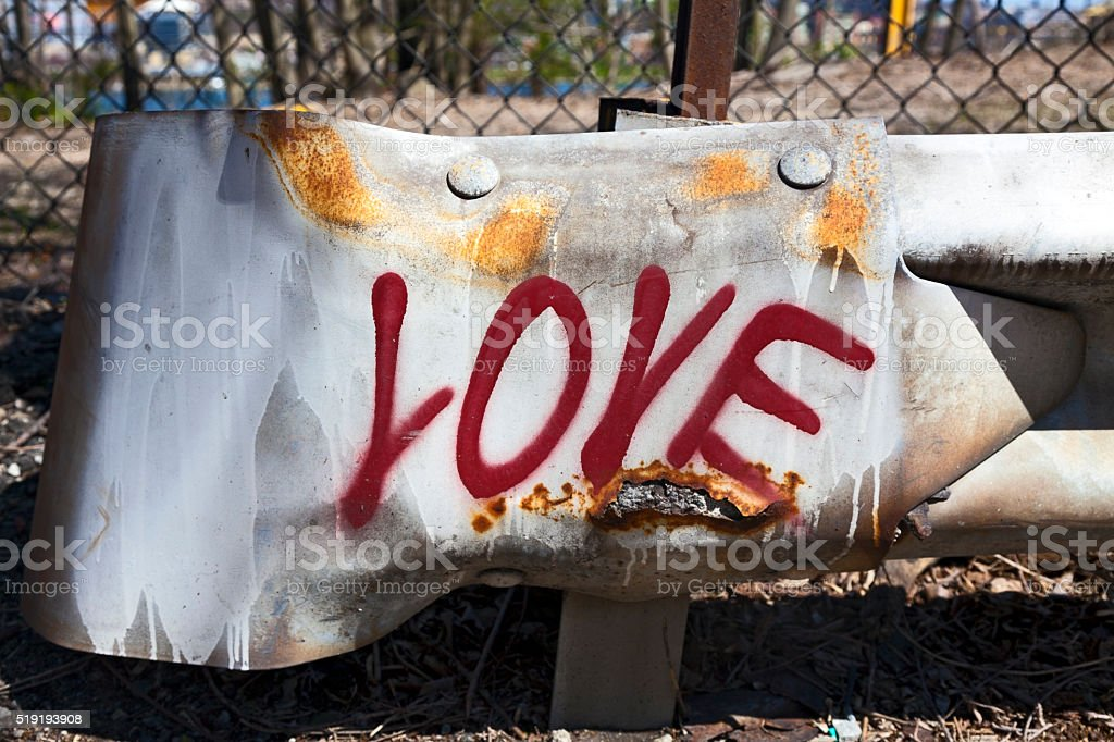 Love on a Weathered Guardrail stock photo