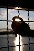 love padlock chained to bridge