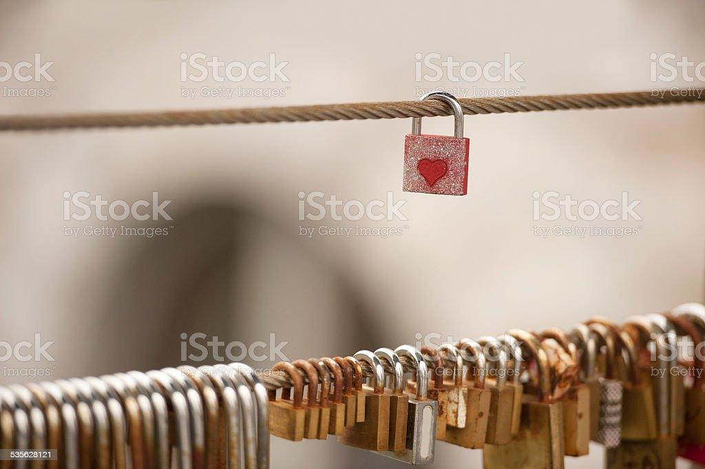 Love padlocks on metal wire stock photo