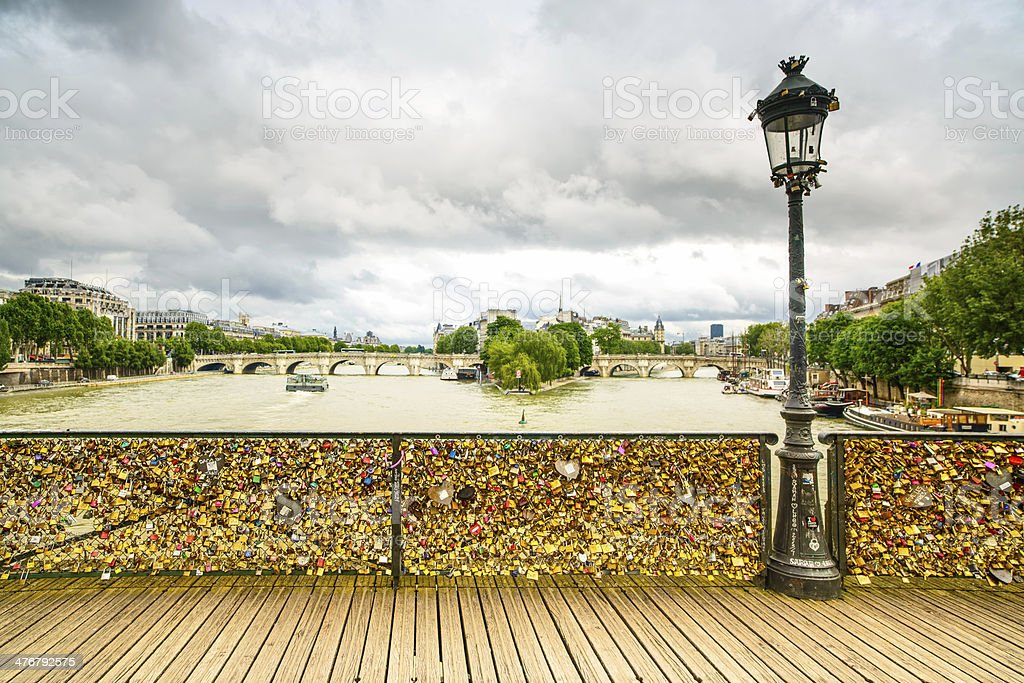 Love padlocks  Pont des Arts bridge, Seine river, Paris, France. stock photo