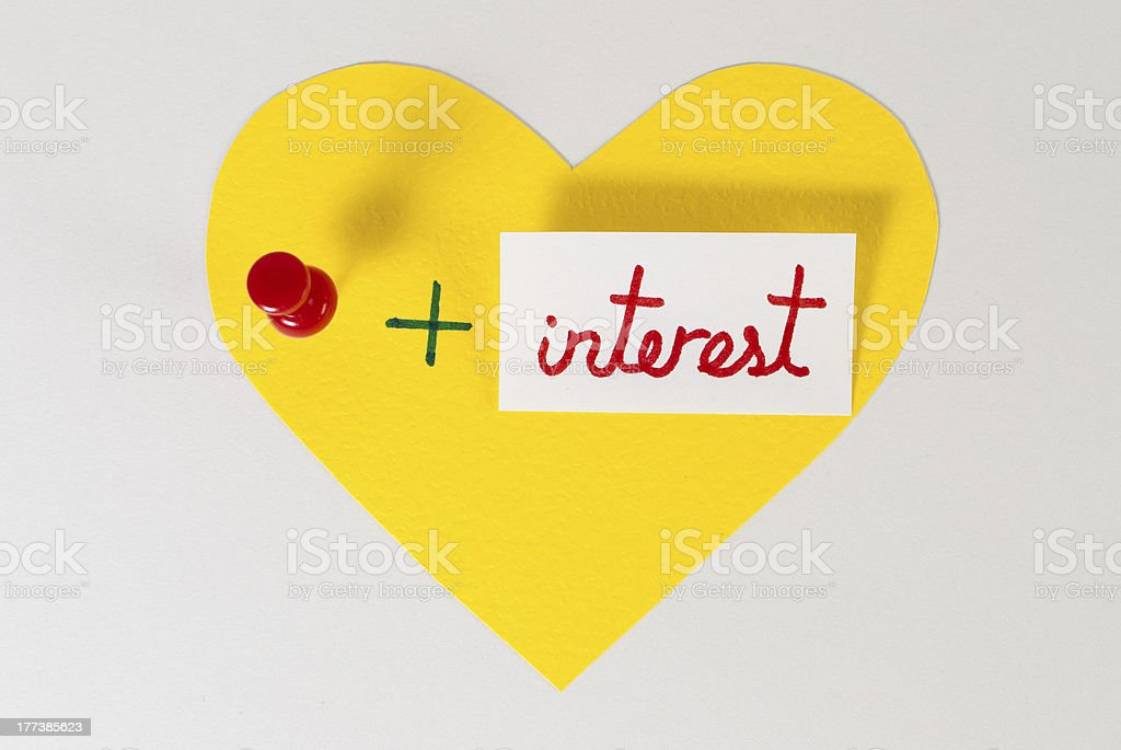 I love pin plus interest. Yellow heart shape. stock photo