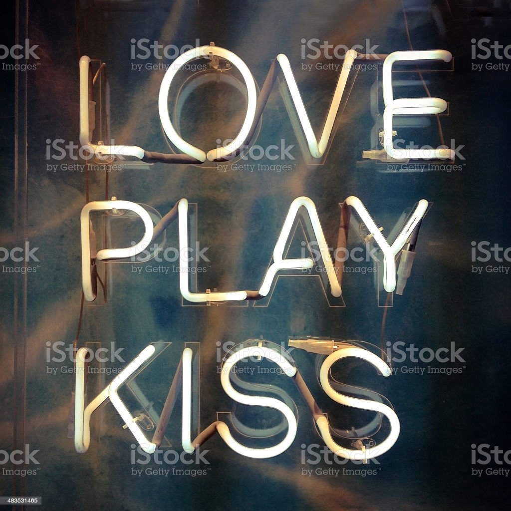 Love, play and kiss stock photo