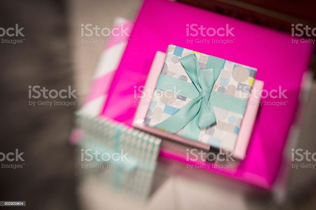Love present on pink wrap paper on tilt shift filter stock photo