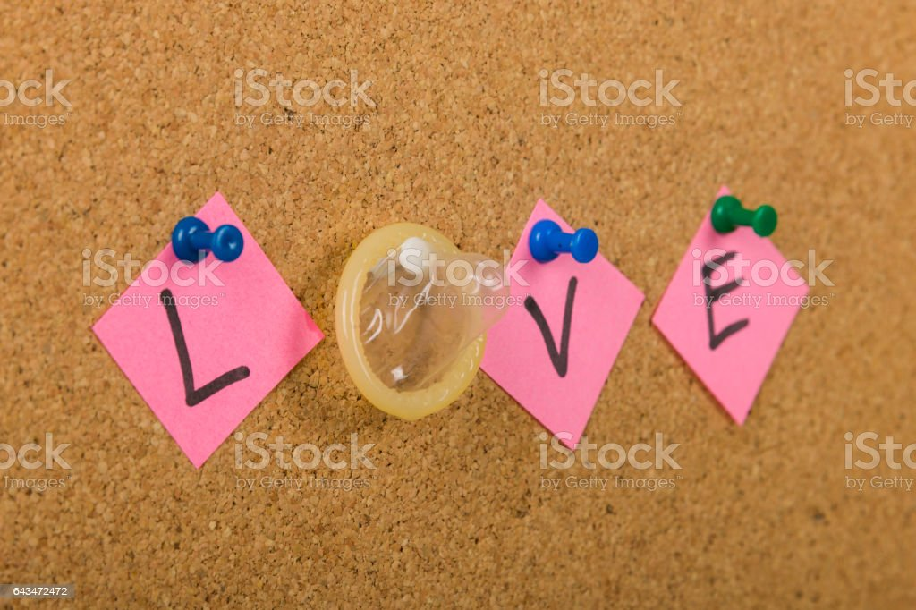 Love, protected by condom stock photo