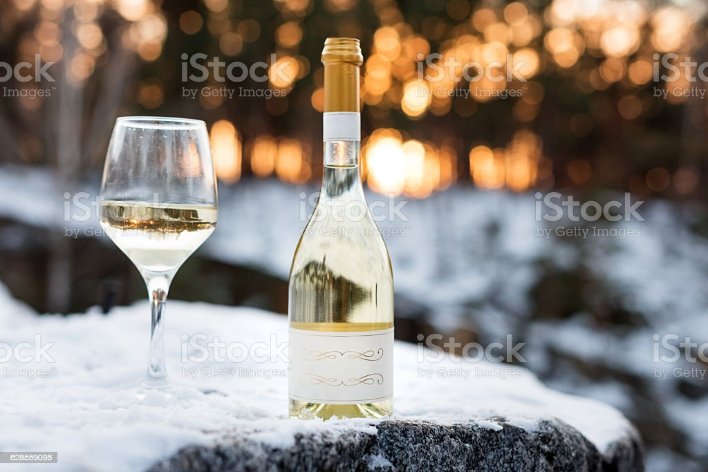 Love, romance, holiday, New Year celebration concept. Bottle and glass stock photo