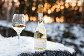 Love, romance, holiday, New Year celebration concept. Bottle and glass