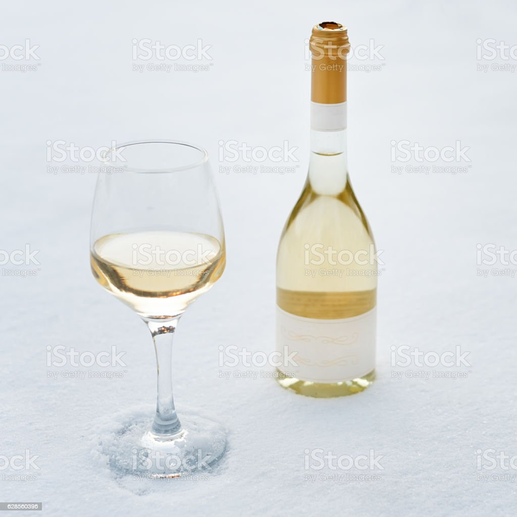 Love, romance, winter holidays, New Year celebration concept. Bottle and stock photo