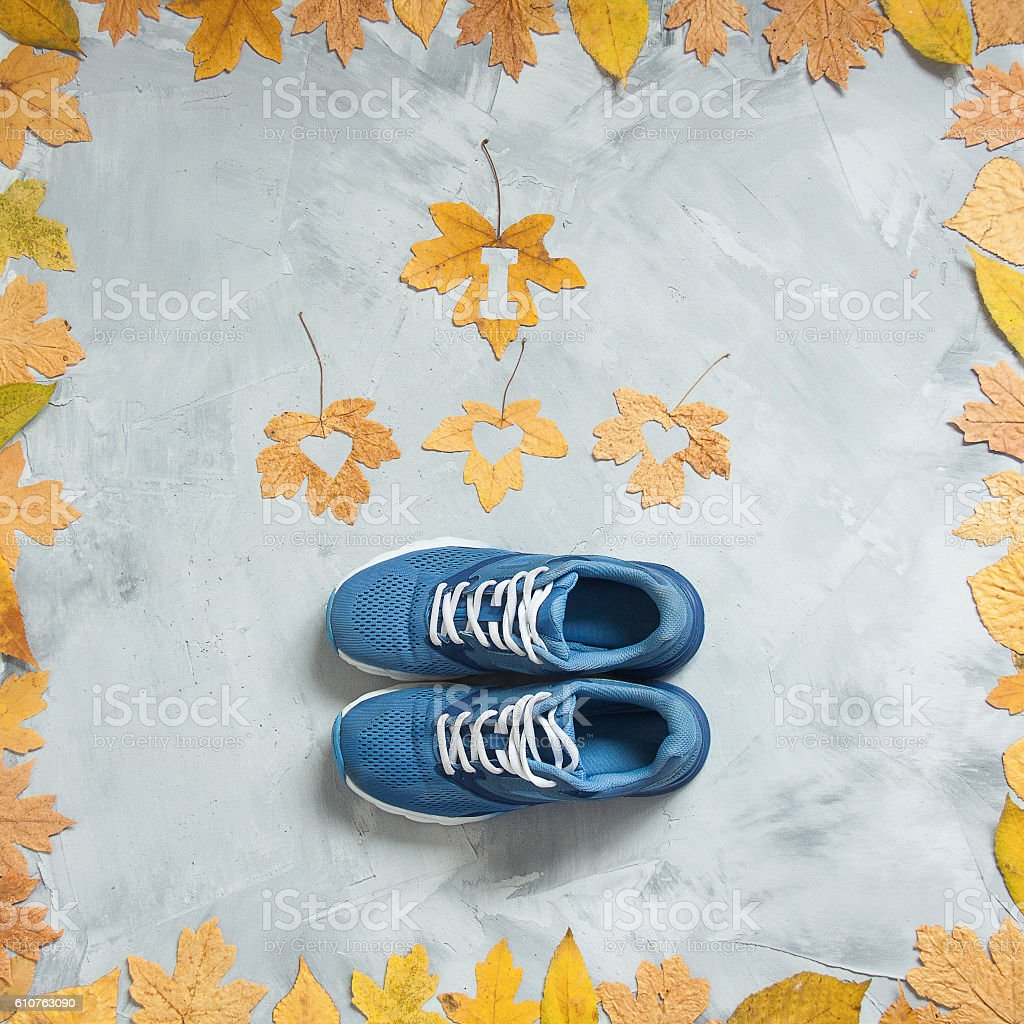 I love running composition with leaves and sport shoes stock photo