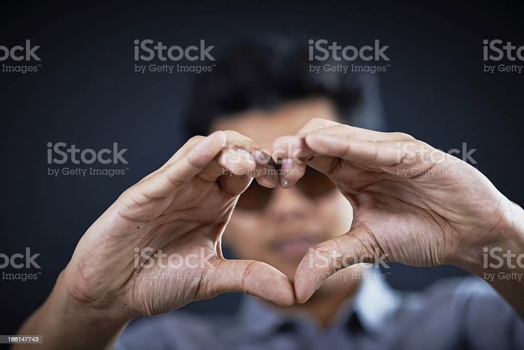 love shape hand by Handsome man royalty-free stock photo