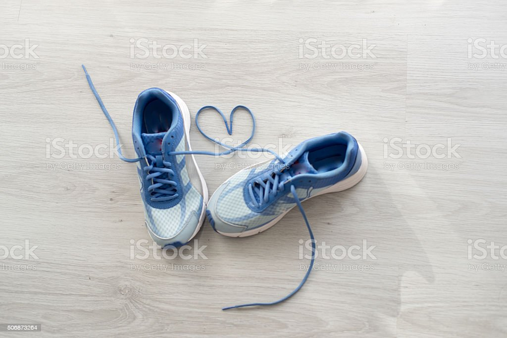 Love sign, Selective focus close up blue sport shoes stock photo