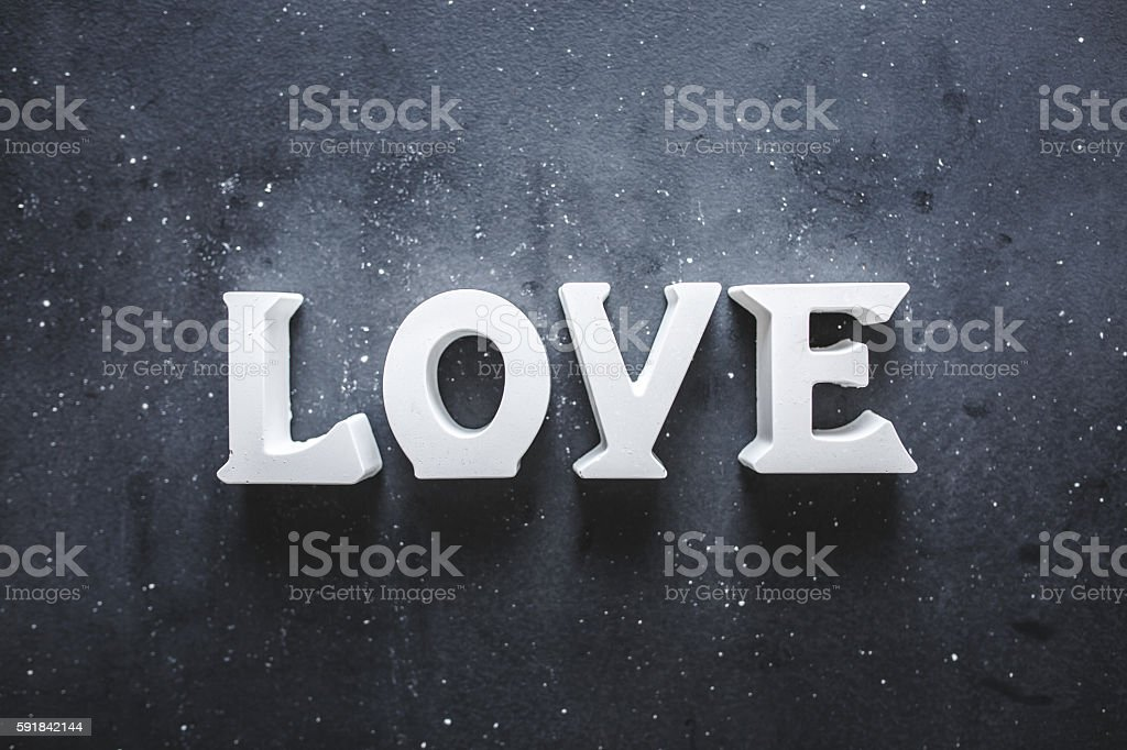 Love single word on blackboard stock photo