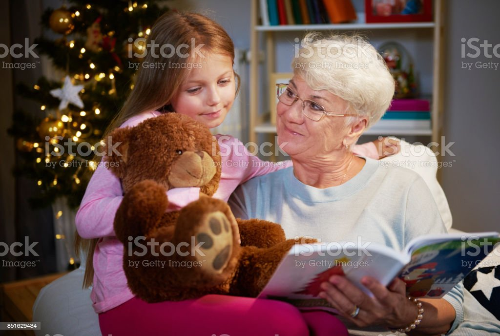 I love spending time with my grandmother and  teddy bear stock photo