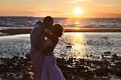 Love story couple wedding on sunset sea. Outdoor
