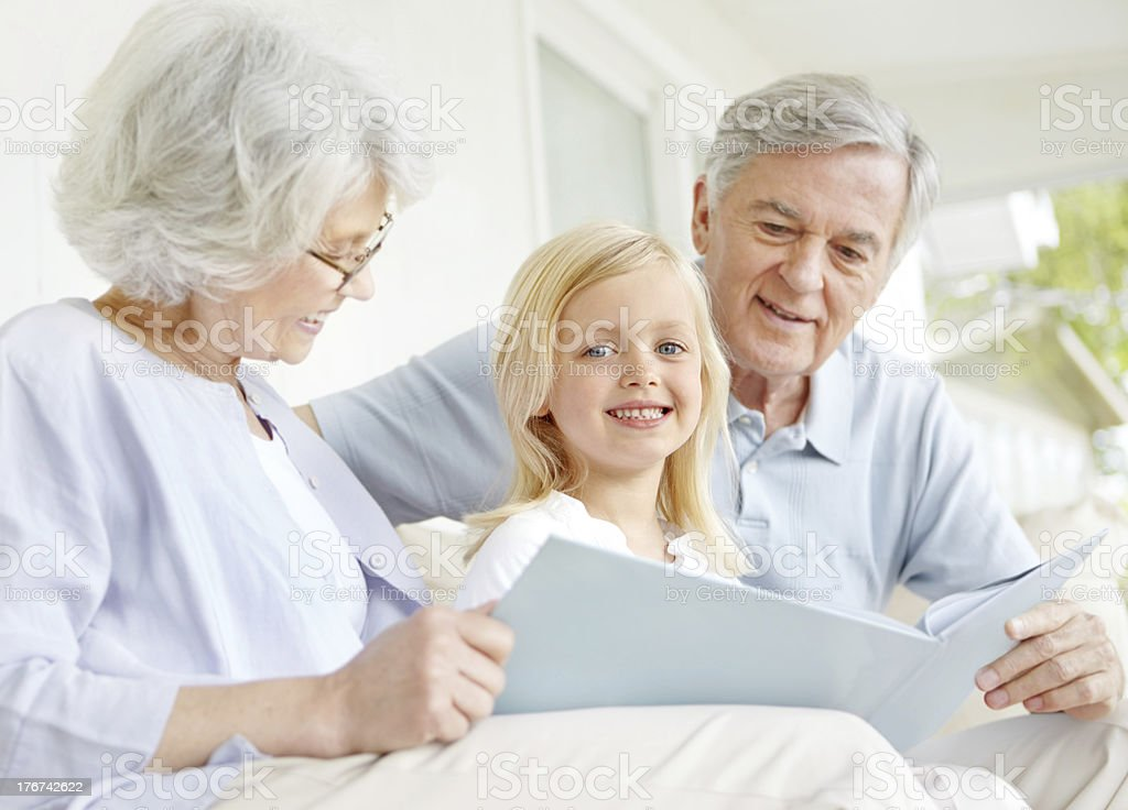 I love storytime with granny and grandpa! royalty-free stock photo