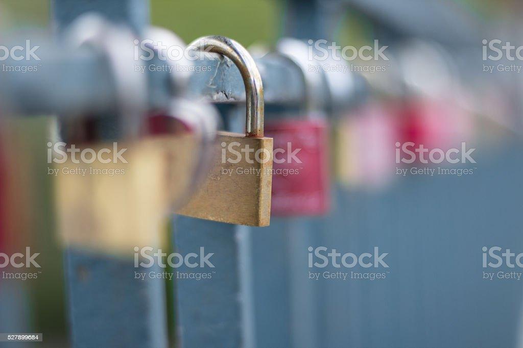 love symbol, padlocks on bridge stock photo