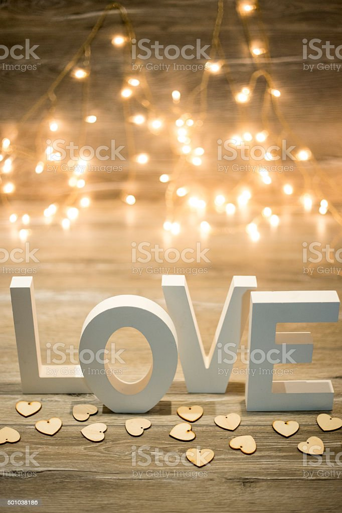love text on wood background for st. valentine stock photo
