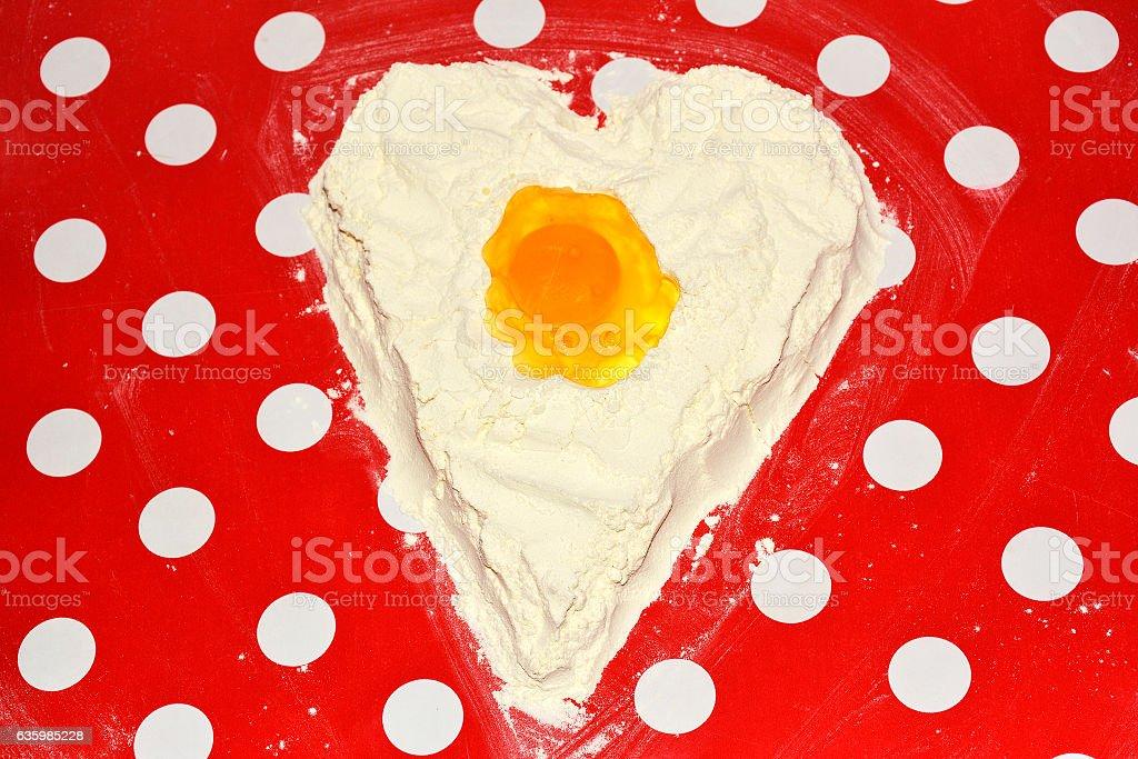 love to bake it! egg yolk on flour stock photo