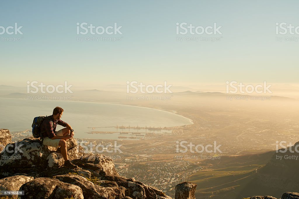 I love to sit on a mountain top and just gaze stock photo