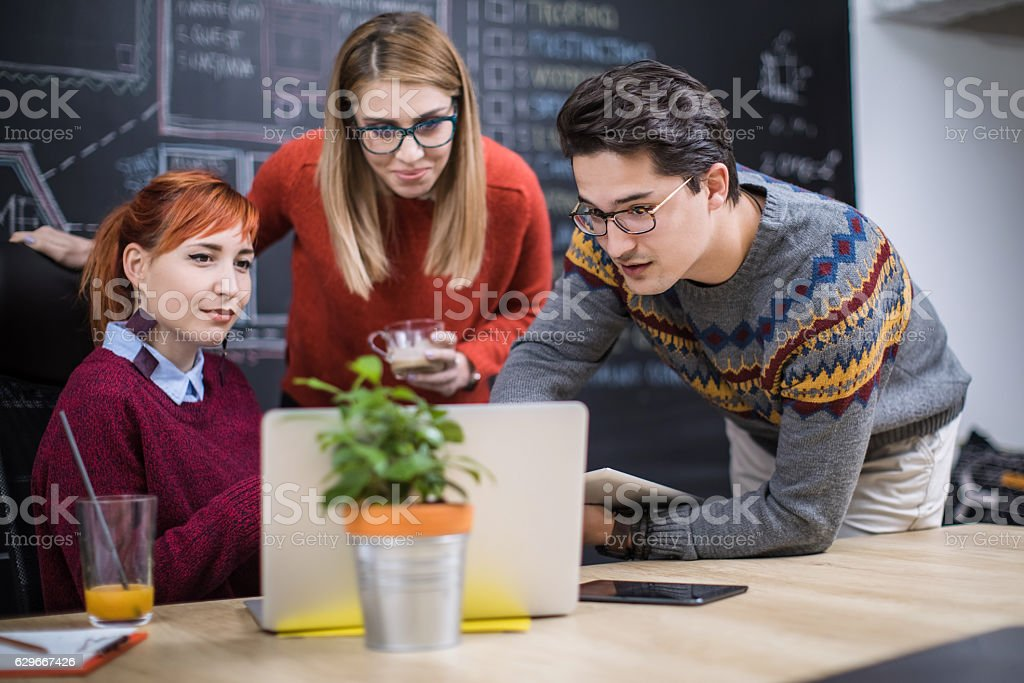 Three colleagues working together on a new plan