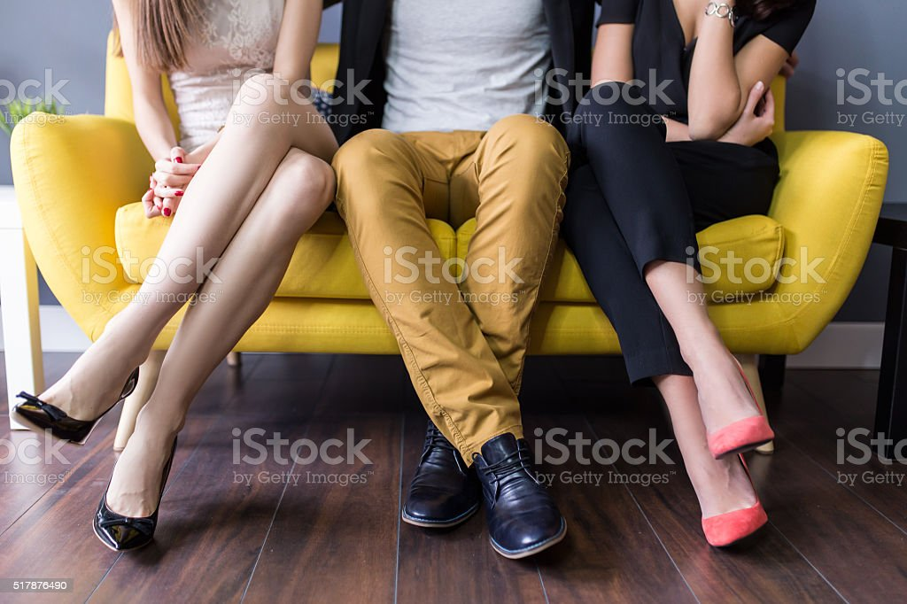 Love triangle, conceptual of a threesome stock photo