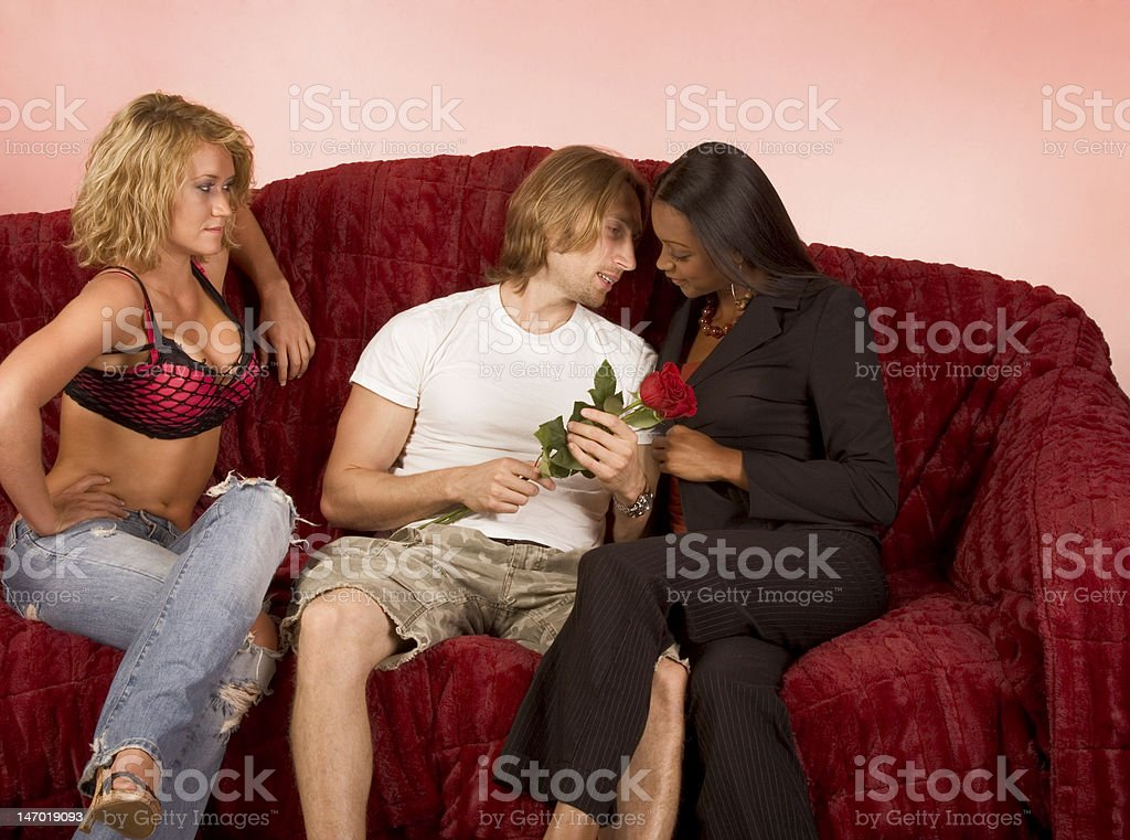 Love triangle drama of two girls and one guy stock photo