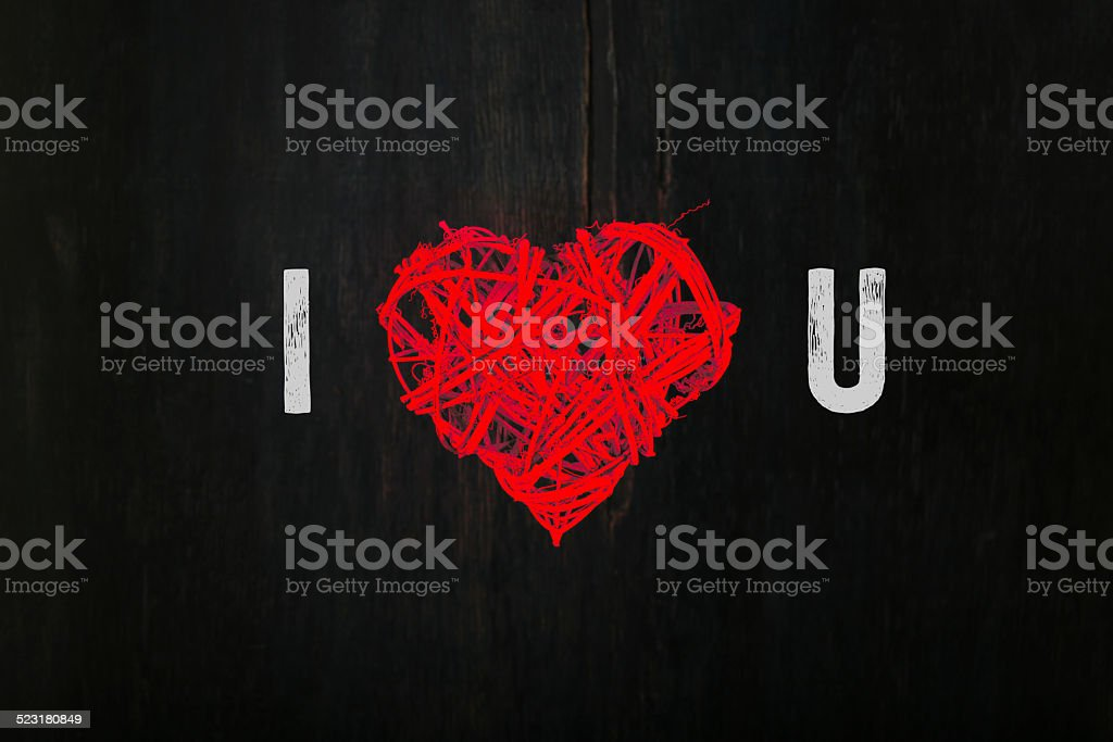 Love Valentines Red Heart Shaped Wreath on Dark Background stock photo