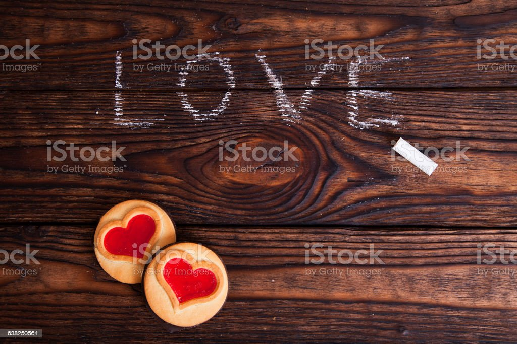 love word written with chalk and cookies stock photo