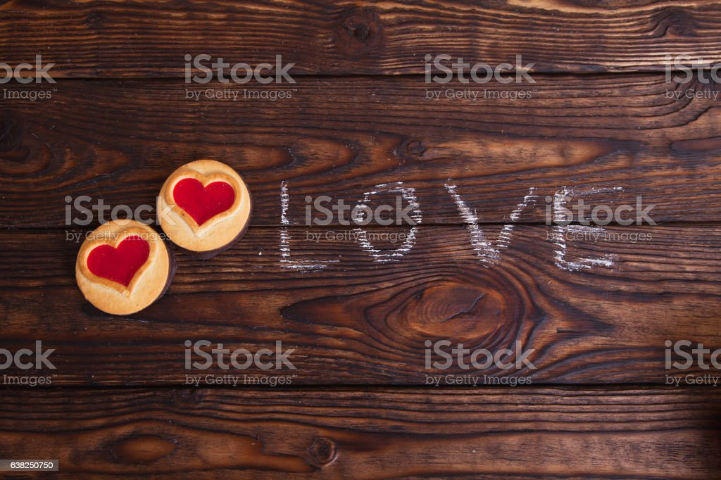 love word written with chalk on a wooden table stock photo