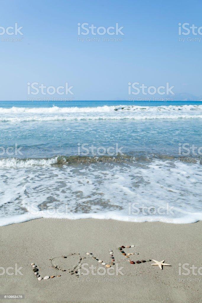 Love write on the Beach stock photo