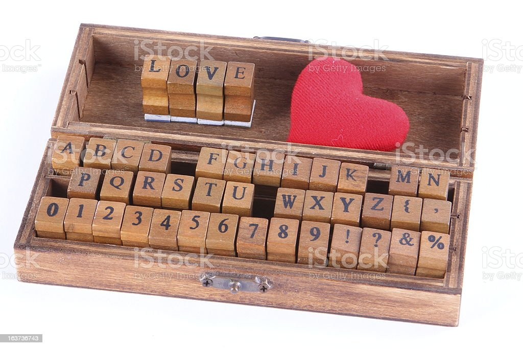 Love written in wood stamp letters royalty-free stock photo