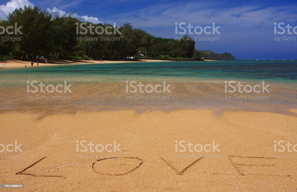 Love written on Hawaii beach sand stock photo