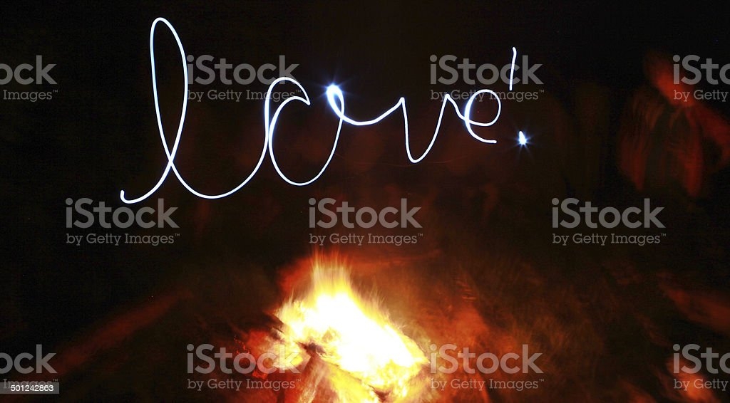 love written with a torch over a campfire stock photo