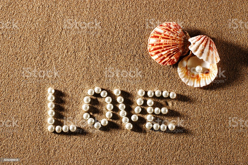 Love written with pearls stock photo