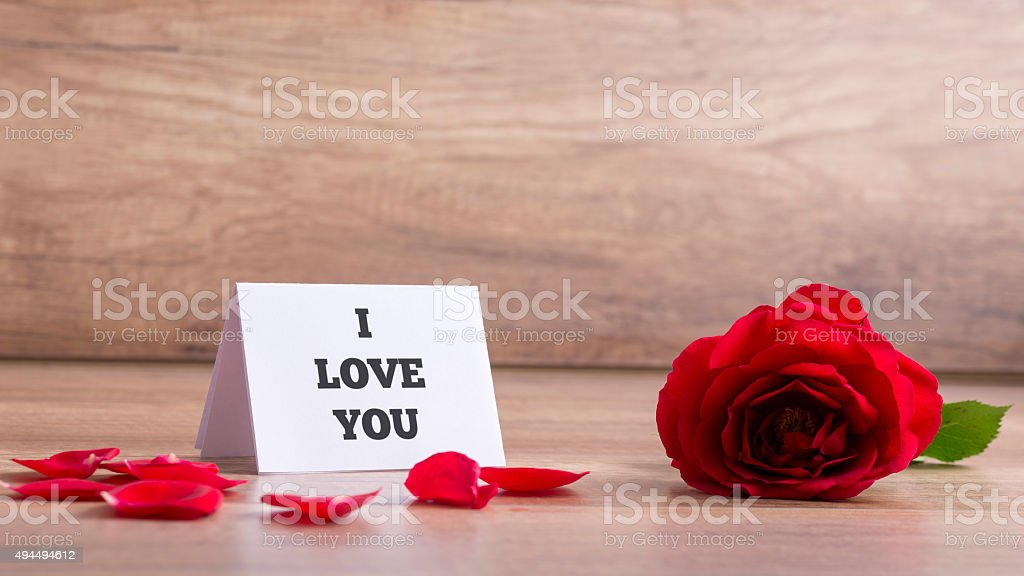 I Love You Card with Red Rose on the Table stock photo