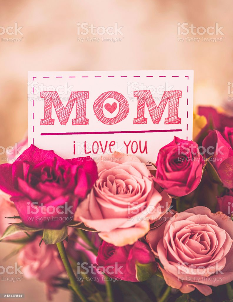 Love you message for mom on Mother's Day with roses stock photo