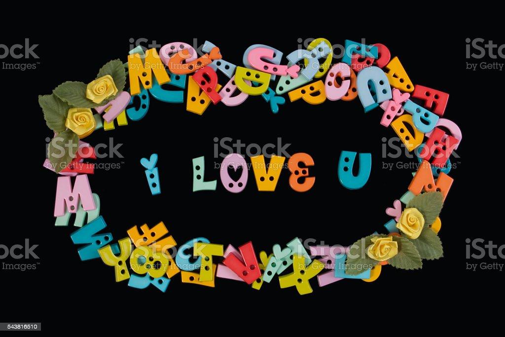 I love you phrase written by plastic letters on blackboard. stock photo