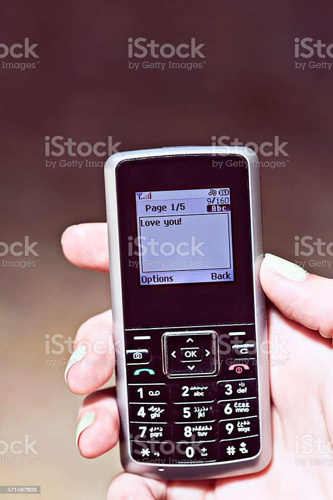 Love you! says affectionat text message on mobile phone screen stock photo